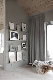 top 25 best grey curtains bedroom ideas on pinterest grey home painting the narrow picture ledges to match the grey walls ensures that the prints stand out in this modern living room space