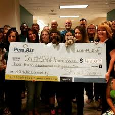 Flag Federal Credit Union Pen Air Presented A Check To Pen Air Federal Credit Union