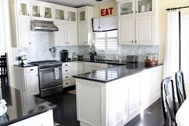 kitchen ideas with black appliances white wooden dining chair