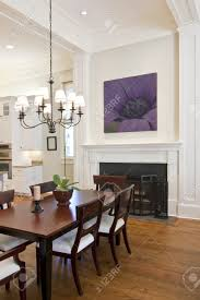 beautiful diningroom with fireplace looking out to kitchen stock