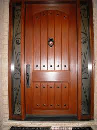 Custom Curb Appeal - fiberglass 8 u0027 plank door with decorative clavos and custom wrought