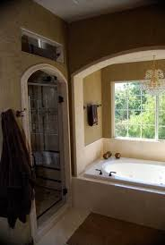 Arched Shower Door Arched Shower Door Tiled With Travertine And Tub Accented With