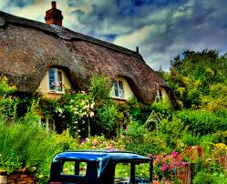 houses thatched garden old fashioned flowers clouds house roof