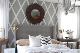 gray headboard under sun wall mirror decor with elegant white