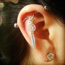 earrings on top of ear absolutely staggering top ear piercings inkdoneright