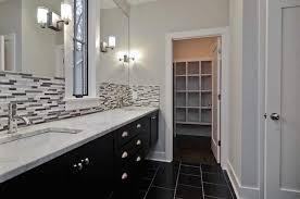 Backsplash For Black Cabinets - bathroom with black cabinets and mosaic backsplash tiles