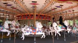 view on a carousel in the park attraction vintage merry go