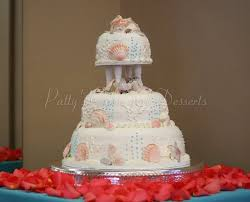 3 tiered beach themed wedding cakes