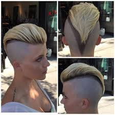 very short pixie hairstyle with saved sides short pixie haircut with comb obver shaved sides and trimmed