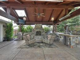 rustic porch with raised beds 61 1 4 rustic porch with calcana wallmount heater ballard designs merida indoor outdoor rug fence skylight outdoor pizza oven