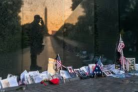 army fallen comrade table script boy in marine uniform lies next to his father s grave at arlington