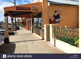 Wall Murals Australia Local Butcher Shop With Wooden Awning And Cartoon Mural On Side