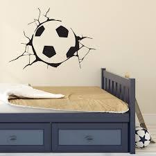 football through the wall kids wall sticker i v c designs ltd football through the wall wall sticker