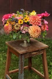 cincinnati florists toned centerpiece with ranunculus sweet pea scabiosa and