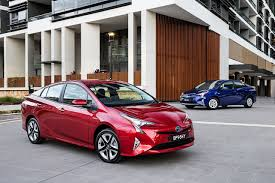 automobile toyota pictures toyota 2016 prius two red blue cars metallic