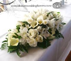 wedding reception bridal table flower arrangement in a