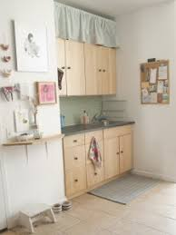 Hang A Curtain Above Kitchen Cabinets To Hide Storage Inside - Above kitchen cabinet storage
