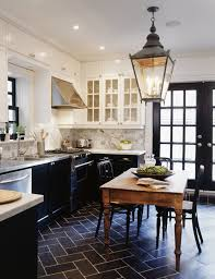 white kitchen cabinets black tile floor white cabinets and black lower cabinets transitional
