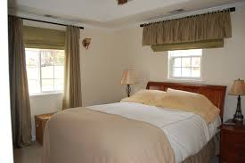 brown fabric master bedroom window treatments faced off queen bed