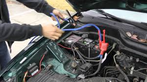 nissan rogue jump start how to properly jump start a car with jumper cables youtube