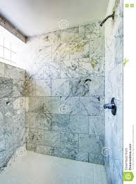 bathroom interior shower cabin with marble tile and small window