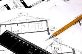 plans et dessins de maison avec un crayon et compas banque d