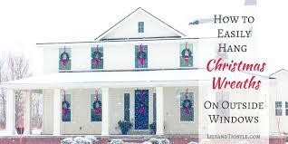 window wreaths how to easily hang christmas wreaths on outside windows