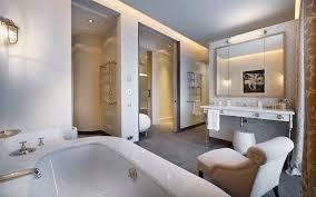 luxury modern bathroom designs features mirror with cream striped