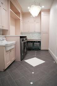 laundry room floor cabinets pink laundry room cabinets with capiz chandelier contemporary
