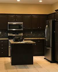 how to paint kitchen cabinets brown how to paint cabinets clare