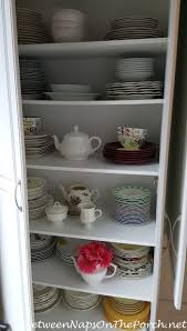 tablescaping storage ideas for dishware flatware napkin rings