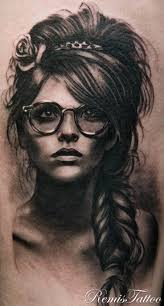 woman with glasses remis tattoo