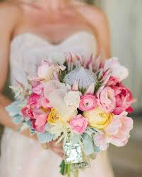 blue wedding bouquets 41 stunning ranunculus wedding bouquets martha stewart weddings