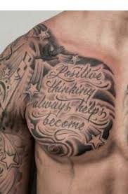 ripped skin scroll chest designs tattoos
