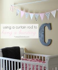 using a curtain rod to hang a bunting simplykierste com