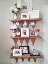 rustic unstained wooden wall shelves for keeping frame picture and