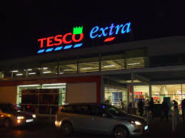 tesco extra st neots proudly wearing a green hat in december