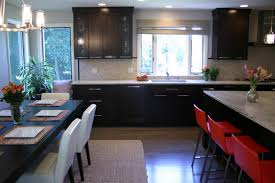 brown wooden cabinet remodeling small kitchen into eat eat kitchen apartment beautiful white tiles countertop plain beige backsplash modern recessed lightings chrome pendant