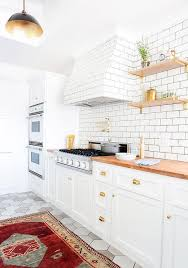 Butcher Block Kitchen Countertops White Kitchen Cabinets With Brass Cup Pulls And Butcher Block