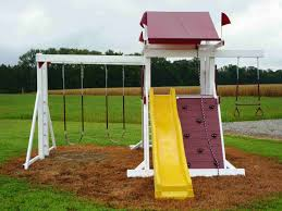 outdoor colorful swings and a slide in the yard with grass and