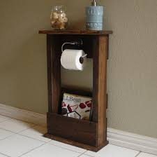toilet paper holder stand with top shelf and storage pocket for