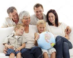 big family on sofa looking at a terrestrial globe stock photo