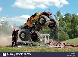 videos of monster trucks crushing cars dragon slayer monster truck jumping over crushed cars inwood