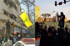 Hezbollah Flag One Is Waving Hezbollah U0027s Flag The Other Was Just Holding Her