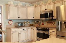 White Painted Cabinets With Glaze by Repaint Kitchen Cabinets Painting Kitchen Cabinets With Chalk