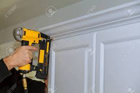 white kitchen cabinets with wood crown molding wood working using brad nail air gun to crown moulding on white