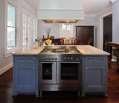 double oven with stove top with traditional kitchen and dark