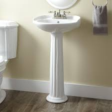 bathroom modern toilet with kohler pedestal sink and vanity