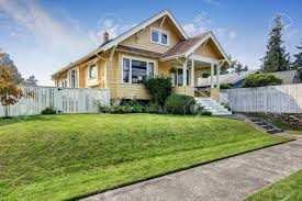 yellow exterior paint american craftsman home with yellow exterior paint and well kept