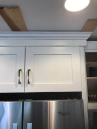 how to install cabinets with uneven ceiling crown molding on uneven ceiling